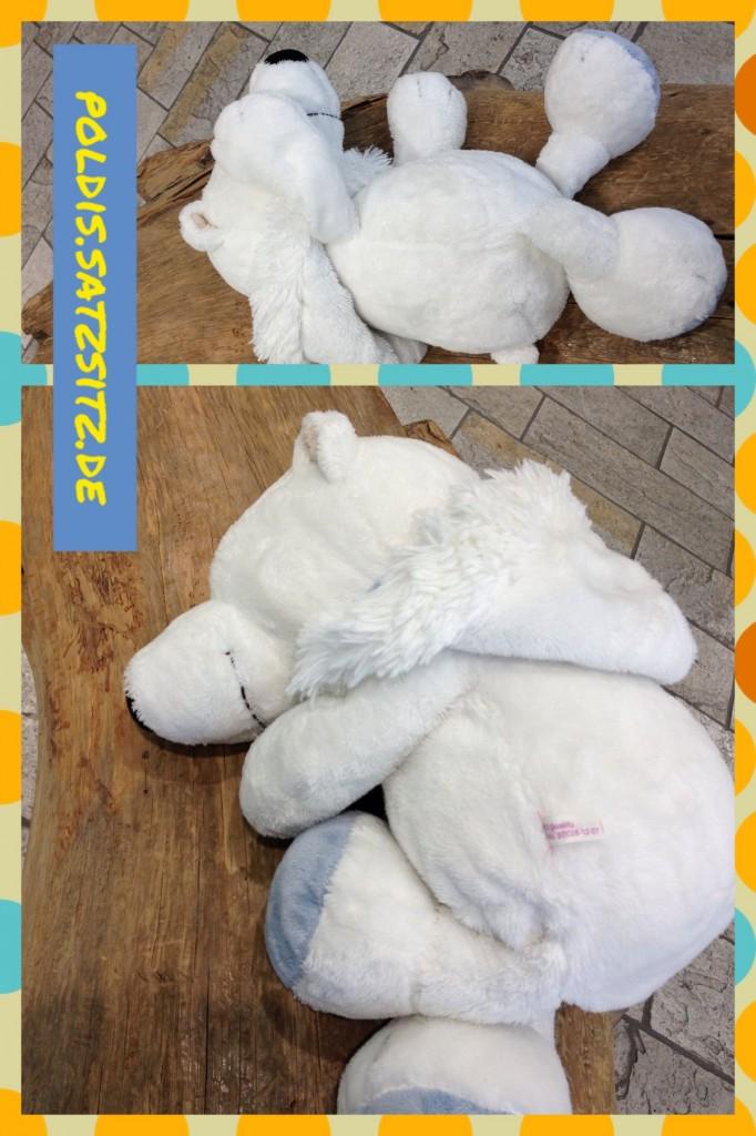 Poldi der Eisbär schläft im Outdoorladen auf einer Holzbank